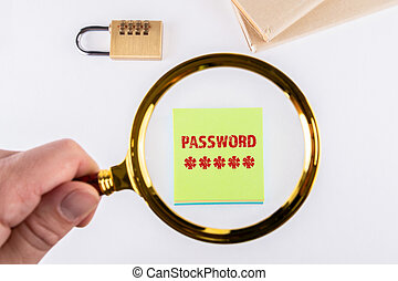 PASSWORD. Data security, identity and social media concept. Man's hand, holding magnifying glass