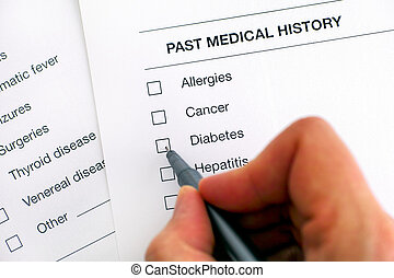 Past medical history questionary. Person hand with pen ready to ticked Diabetes.