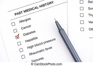 Past medical history questionary with ticked Diabetes and pen.