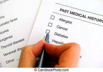 Past medical history questionary. Woman hand with pen ready to ticked Diabetes.