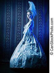 past - Portrait of the elegant woman in medieval era dress.