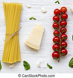 Pasta background. Ingredients for cooking pasta on a white wooden background. Flat lay. From above. Top view, overhead.