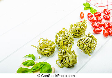 Pasta background - spinach tagliatelle