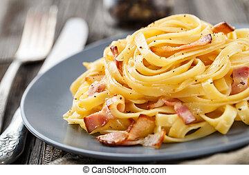 Pasta carbonara - Delicious pasta carbonara on a gray plate