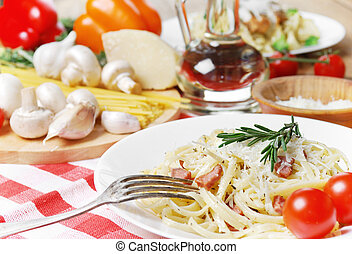 Pasta carbonara on the wooden table - Pasta carbonara in the...