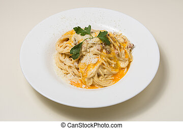 Pasta Carbonara. - Pasta Carbonara on a white plate with ...