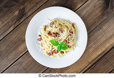 Pasta Carbonara. Spaghetti with bacon and parmesan cheese.
