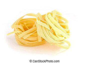Pasta close - Fettuccini nests on white background