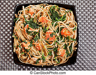 Fettuccine with salmon and spinach, close up