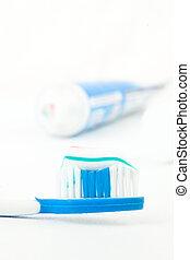 pasta dentífrica, tubo, pincel de diente, luego