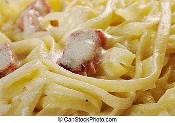 pasta Fettuccine Alfredo with sausage. close-up