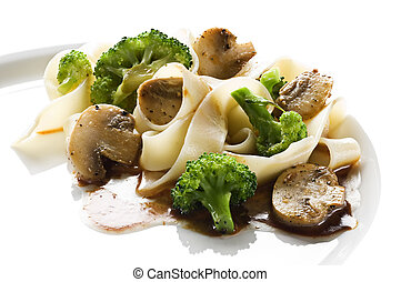 Pasta - Fettuccine pasta with broccoli and mushrooms close...