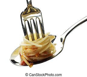 pasta - fresh spaghetti on fork and spoon close up shoot
