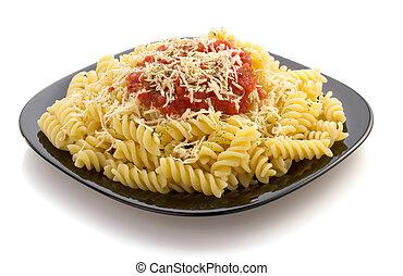 pasta fusilli in plate on white