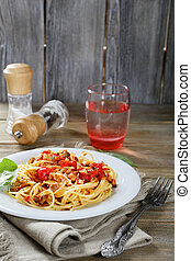 Pasta in a white plate on the boards