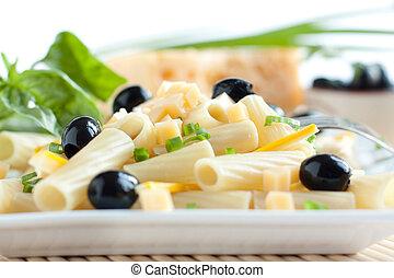 Pasta in a white square bowl