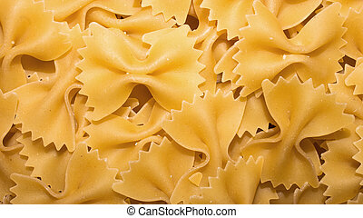Pasta in the form of a butterfly. Background of pasta.