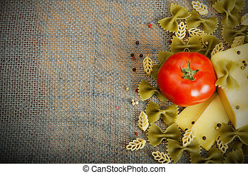 pasta ingredients - tomato with green and white pasta