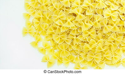 Pasta on the table - Yellow colored raw pasta placed on...
