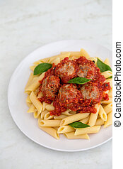 Pasta penne on a white plate
