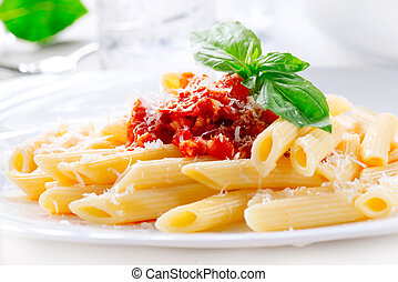 Pasta Penne with Bolognese sauce, Parmesan cheese and Basil