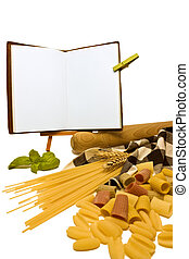 A close up of various pasta and wheat with a rolling pin and table cloth on the right side with fresh basil and an open blank recipe book ideal for copy space. On a white background.