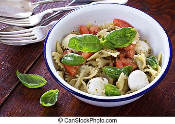 Pasta salad Caprese style with farfalle, tomato and mozarella