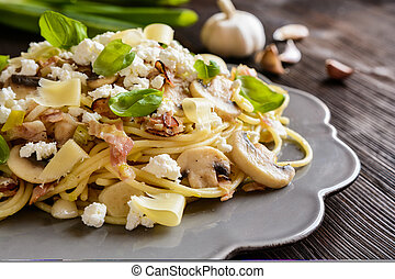 Pasta salad with fried bacon, mushrooms, green onion and cheese