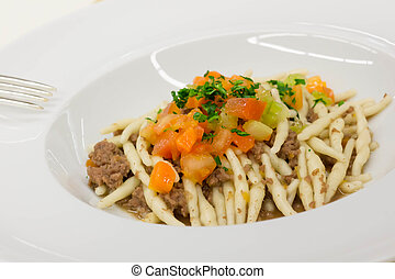 Pasta Strozzapreti with meat sauce and vegetables
