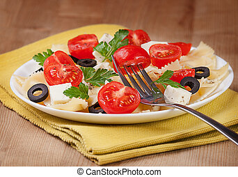 Pasta tomatoes, cheese on a plate