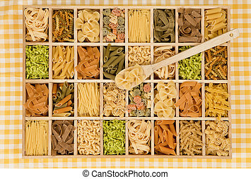 Pasta variation. - Different noodle sorts in wooden box with...