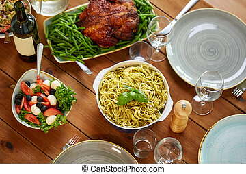 pasta, vegetable salad and other food on table