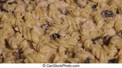 Pasta with creamy mushroom sauce and melted cheese.