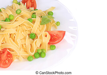 Pasta with green peas on plate close up.