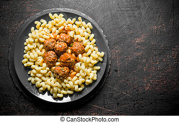 Pasta with meat balls on a plate.
