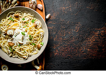 Pasta with mushrooms and sauce in a plate.