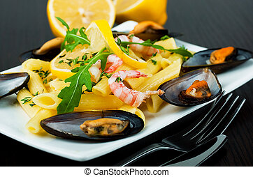 Pasta with mussels, shrimp and lemon, mediterranean cuisine