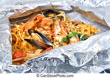 pasta with oysters and tomato in foil