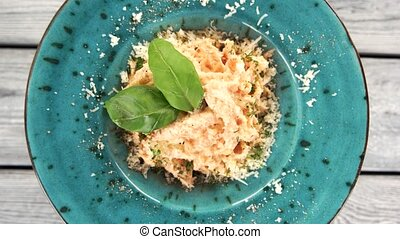 Pasta with parmesan cheese. Italian dish top view.