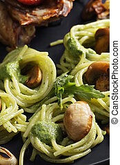 Pasta with pesto and roasted chicken closeup