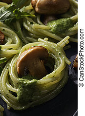 Pasta with pesto sauce closeup