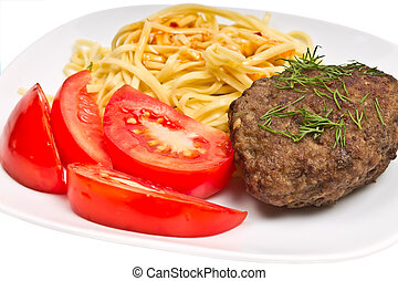 pasta with sauce, cutlet and tomato on a plate