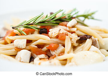 Pasta with sea bream served on a plate - Pasta with sea ...