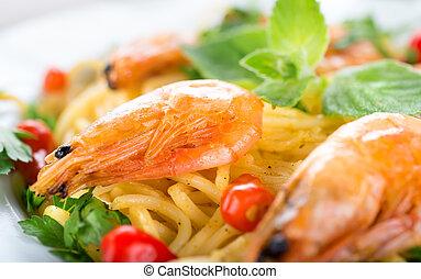 Pasta with shrimps close-up