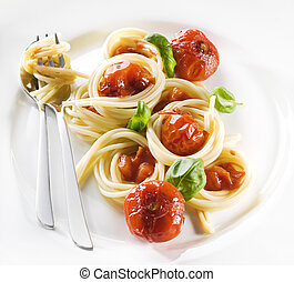 Pasta with tomato sauce and basil close up
