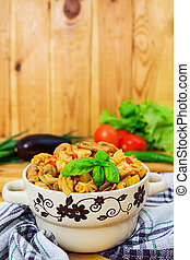 Pasta with vegetable sauce on wooden background