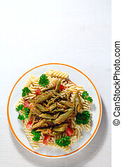 pasta with vegetables: fresh broad beans, tomato sauce, parsley on white background.