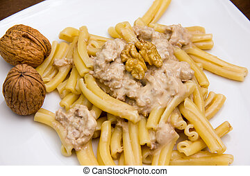 Pasta with walnut pesto close up view