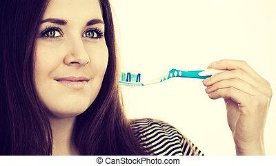 paste., mulher, segura, escova de dentes