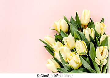 Pastel and yellow tulip flowers bouquet on pink background. Flat lay, top view. Valentine's background. Floral pattern